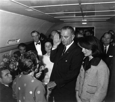 LBJ taking oath on board Air Force One - courtesy of usliberals.about.com